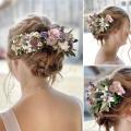 Hochzeitsfrisur mit Blumenkranz